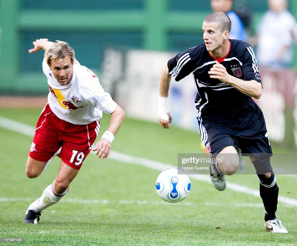 DC United's Joshua Gros right sprints past New York Red Bulls' Chris Henderson at RFK Stadium in Washington DC on Sunday April 2 2006 The Red Bulls...