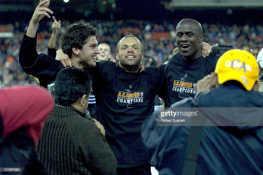 DC United's Santino Quaranta Earnie Stewart and Ezra Hendrickson celebrate the DC United victory in the Conference Finals at RFK Stadium in...