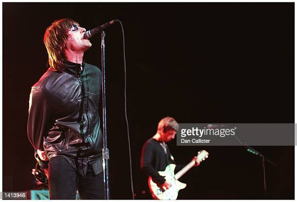 E367335 04/09/00 Universal City CA Lead singer of rock group OASIS Liam Gallagher plays to a sell out crowd at the Universal Amphitheatre Picture by...