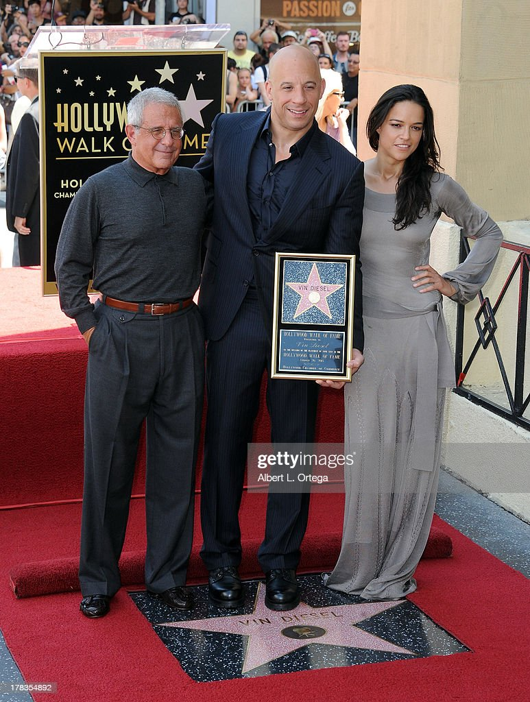 Universal COO Ron Meyer, actor Vin Diesel and actress Michelle Rodriguez participates in the Star Ceremony for Vin Diesel on the Hollywood Walk Of Fame held on August 26, 2013 in Hollywood, California.
