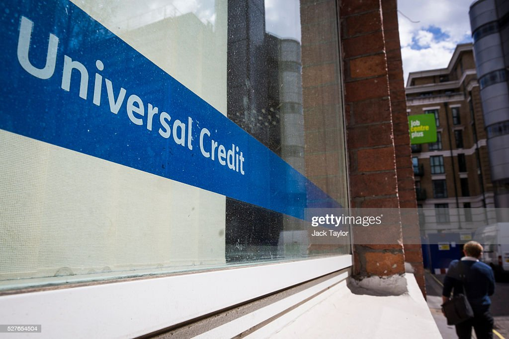 A Universal Credit sign in the window of the Job Centre in Westminster on May 3, 2016 in London, England. The Resolution Foundation, chaired by former Conservative Minister David Willets, has said the Government's benefit reform has 'veered off track' due to cost-cutting. They say that 2.5 million families could be worse off, some by over ��3,000 a year. Universal Credit is a single payment and replaces six current benefits, including Jobseeker's Allowance and Employment and Support Allowance.