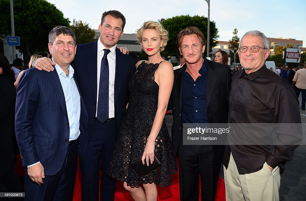 Universal Filmed Entertainment Group Chairman Jeff Shell, producer <a gi-track='captionPersonalityLinkClicked' href=/galleries/search?phrase=Scott+Stuber&family=editorial&specificpeople=240333 ng-click='$event.stopPropagation()'>Scott Stuber</a>, actress <a gi-track='captionPersonalityLinkClicked' href=/galleries/search?phrase=Charlize+Theron&family=editorial&specificpeople=171250 ng-click='$event.stopPropagation()'>Charlize Theron</a>, actor <a gi-track='captionPersonalityLinkClicked' href=/galleries/search?phrase=Sean+Penn&family=editorial&specificpeople=202979 ng-click='$event.stopPropagation()'>Sean Penn</a> and NBCUniversal Vice Chairman <a gi-track='captionPersonalityLinkClicked' href=/galleries/search?phrase=Ron+Meyer&family=editorial&specificpeople=213476 ng-click='$event.stopPropagation()'>Ron Meyer</a> attend the premiere of Universal Pictures and MRC's 'A Million Ways To Die In The West' at Regency Village Theatre on May 15, 2014 in Westwood, California.
