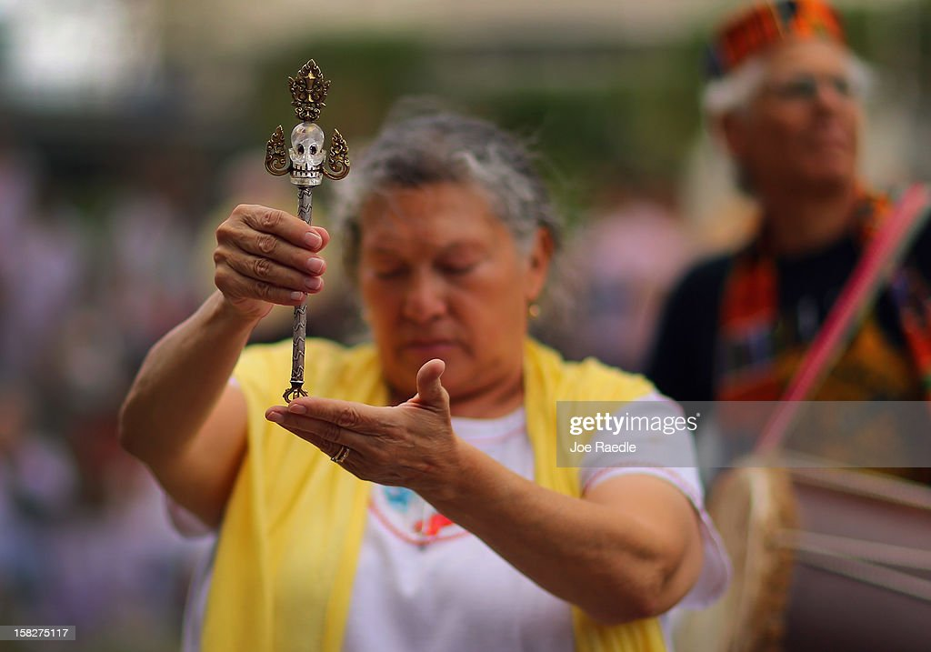 Universal Healer, Flordemayo, holds a sacred staff as she leads a sacred 12.12.12 ceremony with ancient crystal skulls at Miami Circle which is a Tequesta indian site used centuries ago on December 12, 2012 in Miami, United States. The ceremony was held on the calender date of 12-12-12 which is the last major numerical date using the Gregorian or Christian calendar for almost another century.