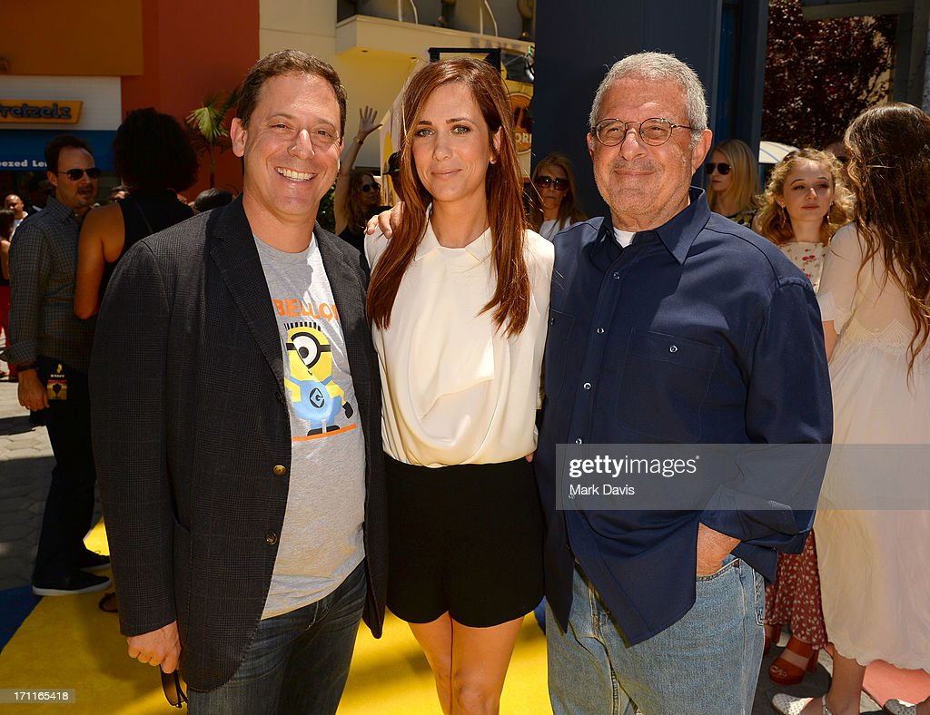Universal Pictures Chairman Adam Fogelson, actress Kristen Wiig and Chief Operating Officer of Universal Studios Ron Meyer arrive at the premiere of Universal Pictures' 'Despicable Me 2' at Gibson Amphitheatre on June 22, 2013 in Universal City, California.
