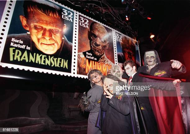 Universal Studios actors dressed as monsters portraying Dracula Frankenstein The Mummy Wolfman and the Phantom of the Opera pose 30 September in...