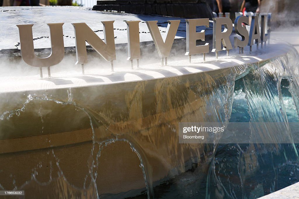 Universal Studios signage sits above a fountain at Universal Studios Hollywood theme park in Hollywood, California, U.S., on Thursday, Aug. 15, 2013. NBC Universal, majority owned by Comcast Corp., operates some of the most-watched U.S. cable TV channels, in addition to its flagship broadcast network, a film studio and the Universal Studios amusement parks. Photographer: Patrick T. Fallon/Bloomberg via Getty Images