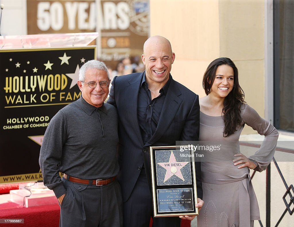 Universal's Ron Meyer, Vin Diesel and Michelle Rodriguez attend the ceremony honoring Vin Diesel with a Star on The Hollywood Walk of Fame held on August 26, 2013 in Hollywood, California.