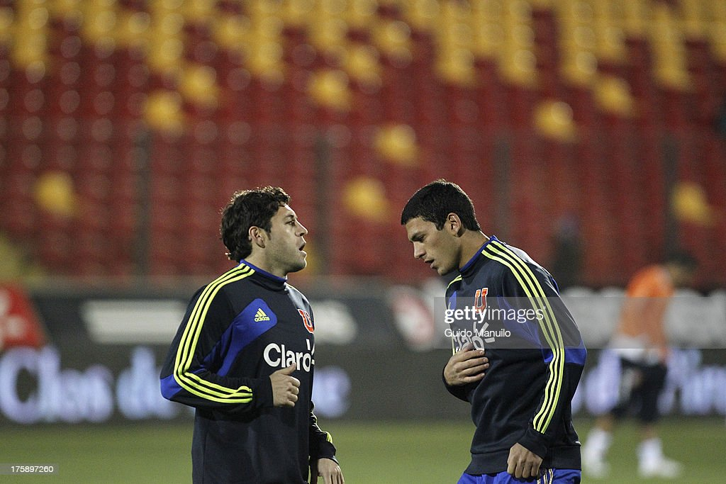 Universidad de Chile's Juan Rodrigo Rojas (L) and Isacc Díaz, during warm up during a match between Universidad de Chile and Cobresal as part of the Torneo Apertura 2013 at Santa Laura Stadium on August 09, 2013 in Santiago, Chile.