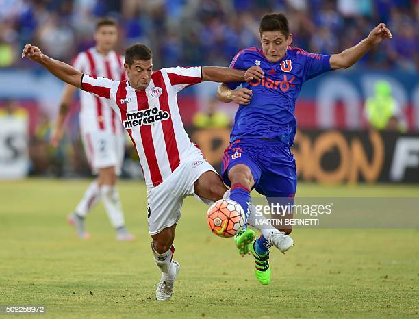 Universidad de Chile's Matias Rodriguez vies for the ball with Uruguay's River Plate footballer Diego Rodriguez during their Copa Libertadores 2016...