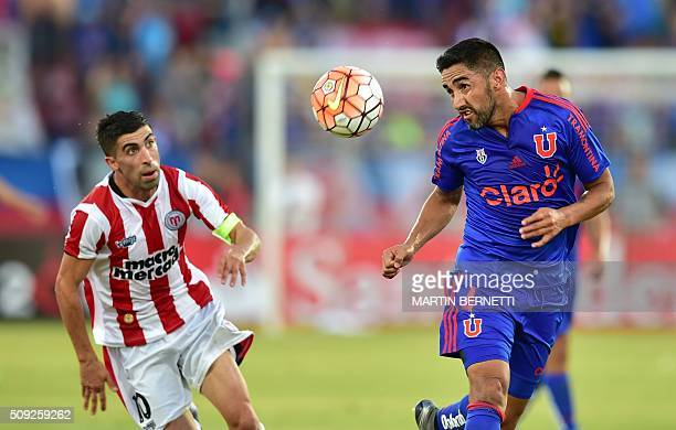 Universidad de Chile's Osvaldo Gonzalez vies for the ball with Uruguay's River Plate footballer Michael Santos during their Copa Libertadores 2016...