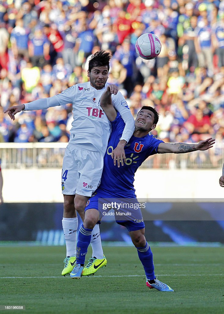 Universidad de Chile's player Charles Aranguiz fights for the ball whit Claudio Meneses, during a match between O'Higgins and U de Chile as part of the Torneo Apertura at National Stadium, on October 05, 2013 in Santiago, Chile.