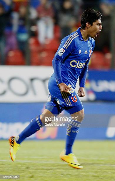 Universidad de Chile's player Patricio Rubio celebrates after scoring during a match between Union Española and U de Chile as part of the Torneo...