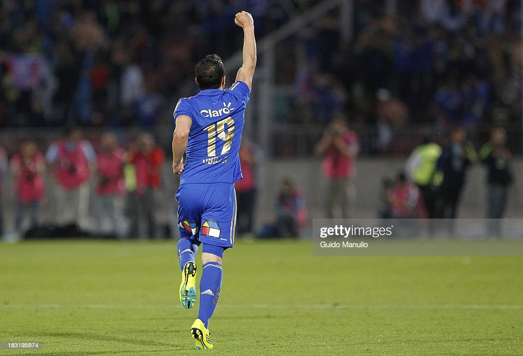Universidad de Chile's player Sebastián Ubilla, celebrates after scoring during a match between O'Higgins and U de Chile as part of the Torneo Apertura at National Stadium, on October 05, 2013 in Santiago, Chile.