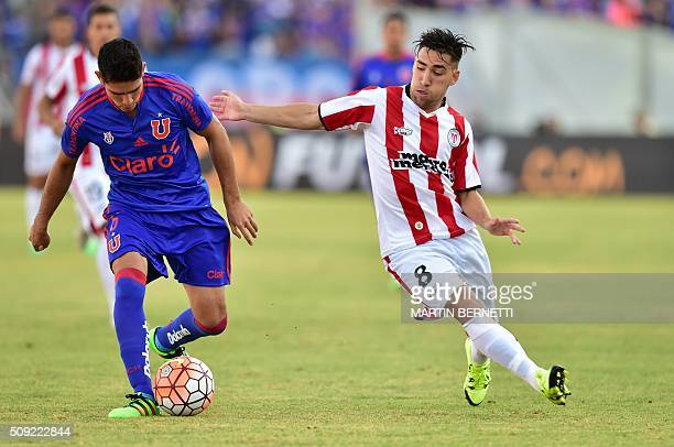 Universidad de Chile's Sebastian Martinez vies for the ball with Uruguay's River Plate footballer Fernando Gorriaran during their Copa Libertadores...