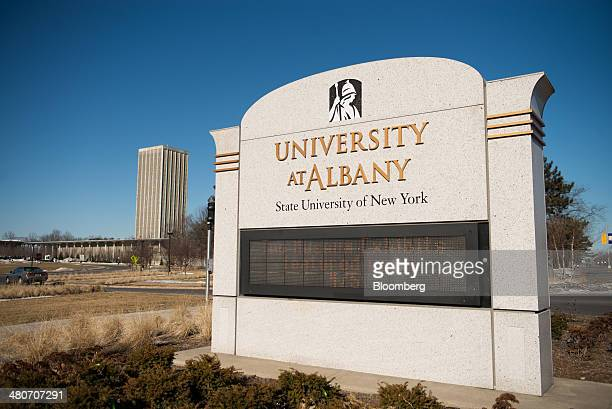A University at Albany State University of New York sign stands in Albany New York US on Wednesday March 19 2014 Budget talks among New York Governor...