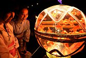 University exchange students Hsiao Yu Hsun and Tsai Yi Chun from Taiwan look at goldfish in a decorative ball tank during a press preview of the 2016...