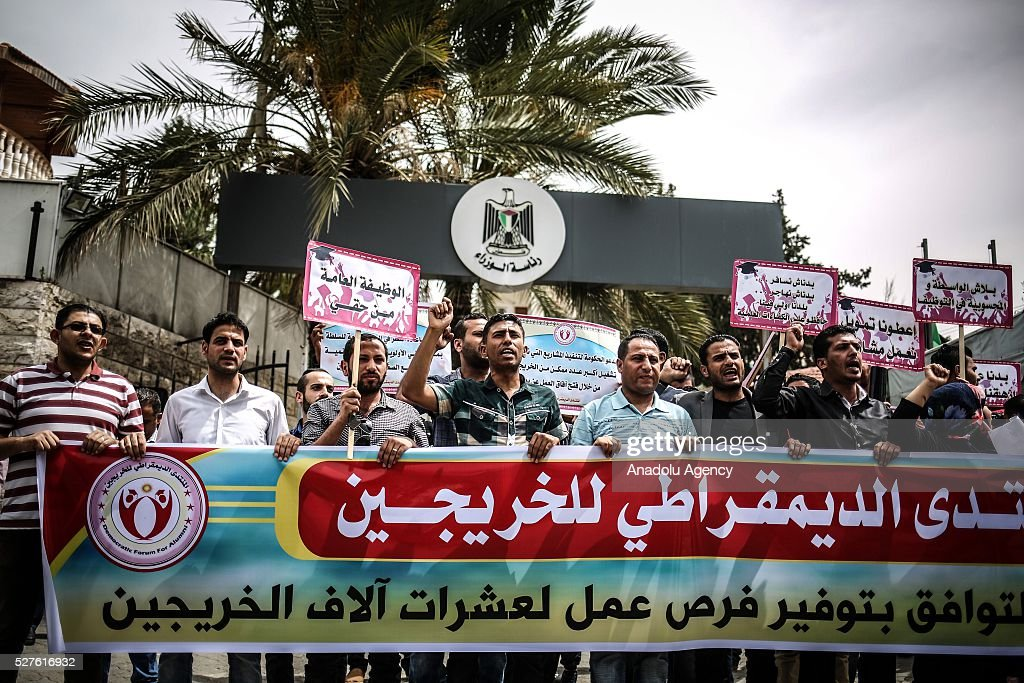 University graduates supporting the Democratic Front for the Liberation of Palestine (DFLP) stage a protest against the unemployment in front of the government building in Gaza City, Gaza on May 3, 2016.
