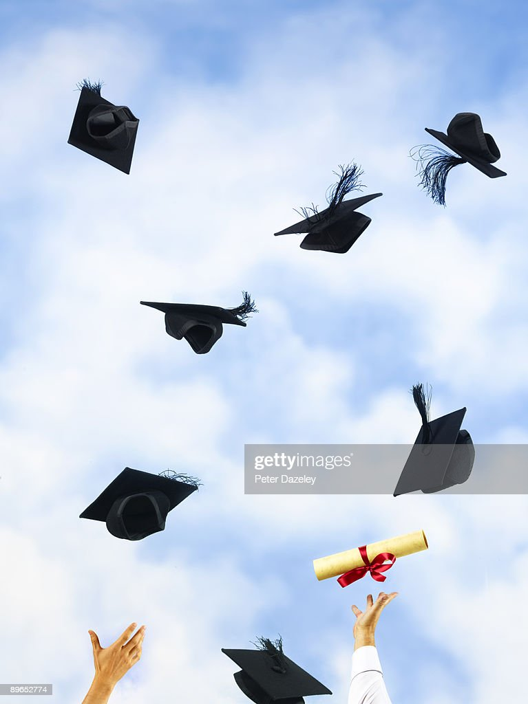 University mortarboards and certificates. : Stock Photo