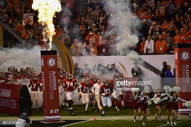 University of Alabama defensive lineman Jonathan Allen and University of Alabama head coach Nick Saban lead the team out of the tunnel prior to the...