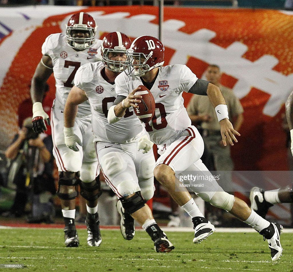 University of Alabama quarterback A J McCarron scrambles out of the pocket in the second quarter of the BCS National Championship game against Notre Dame at Sun Life Stadium in Miami Gardens, Florida, on Monday, January 7, 2013.