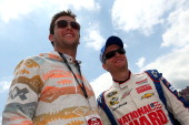 University of Alabama quarterback AJ McCarron and Dale Earnhardt Jr driver of the National Guard Chevrolet pose for a photo on the grid prior to the...