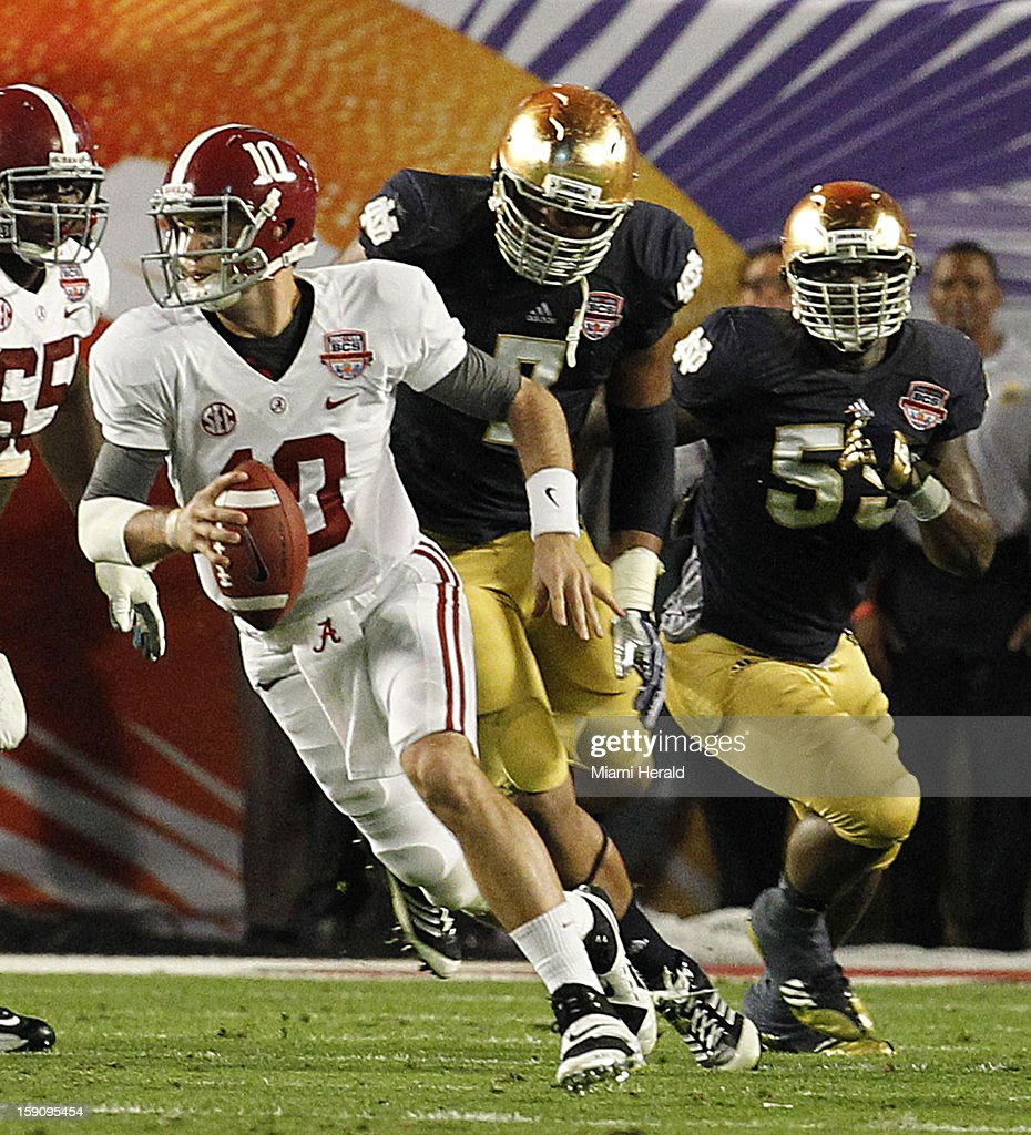 University of Alabama quarterback A.J. McCarron scrambles out of the pocket in the second quarter of the BCS National Championship game against Notre Dame at Sun Life Stadium in Miami Gardens, Florida, on Monday, January 7, 2013.