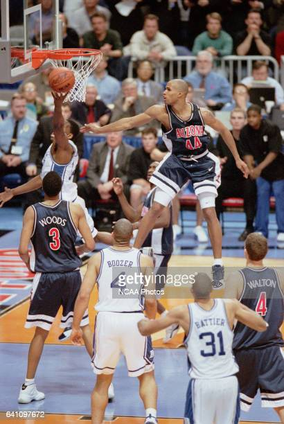 University of Arizona forward Richard Jefferson goes airborne in an attempt to block Duke University guard Nate James shot during the NCAA Men's...