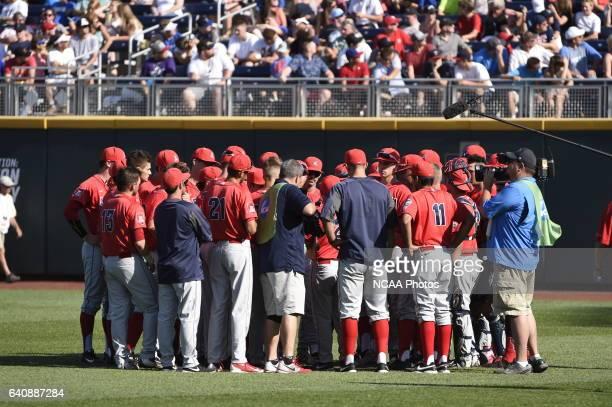 University of Arizona huddle up before the start of the Division I Men's Baseball Championship against Coastal Carolina University held at TD...