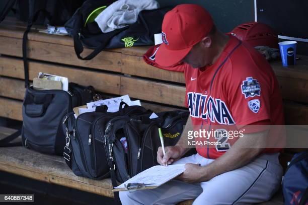 University of Arizona players prepare before taking on Coastal Carolina University during the Division I Men's Baseball Championship held at TD...