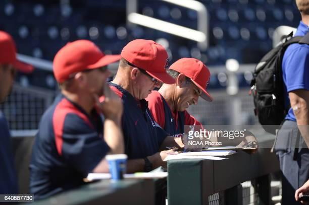 University of Arizona players warm up on the field before taking on Coastal Carolina University during the Division I Men's Baseball Championship...