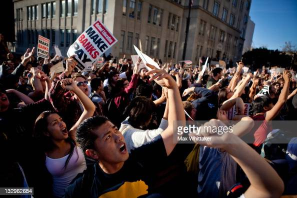 University of California Berkeley students urge onlookers to join them as they march through Berkeley as part of an 'open university' strike in...