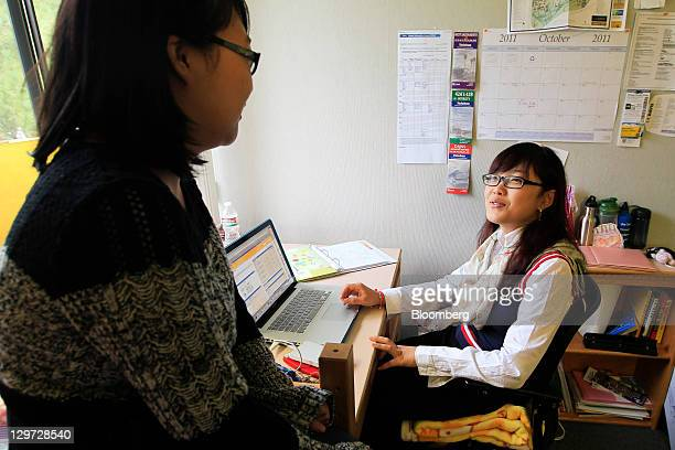 University of California freshmen Guan Wang right and Tracy Chen chat in a dorm room in Davis California US on Monday Oct 10 2011 Seeking the world's...