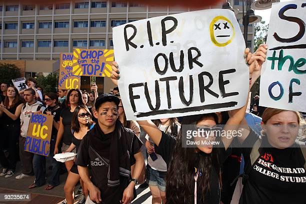 University of California Los Angeles students Andrea Flores and Kendall Brown and other UCLA students and supporters demonstrate outside the UC Board...