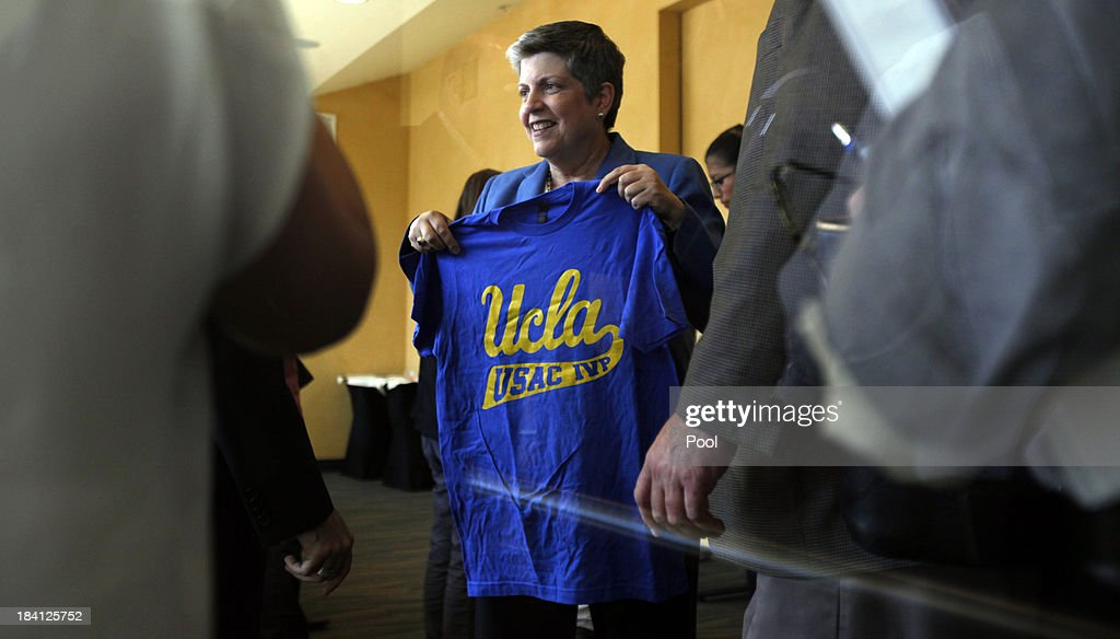 University of California President <a gi-track='captionPersonalityLinkClicked' href=/galleries/search?phrase=Janet+Napolitano&family=editorial&specificpeople=589781 ng-click='$event.stopPropagation()'>Janet Napolitano</a> is presented with a t-shirt after having lunch with a group of students at UCLA October 11, 2013 in Westwood, California. Napolitano toured UCLA for the first time since she assumed office, meeting privately with administrators, faculty and students.