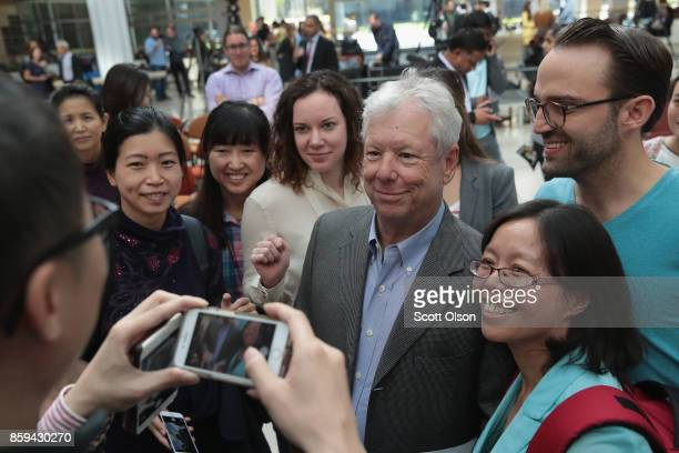 University of Chicago Professor Richard Thaler poses for pictures following a reception at the university after learning he had been awarded the 2017...