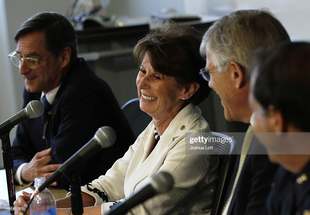 University of Colorado Anschutz Medical Campus Dean of the Graduate School Barry Shur from left, Executive Vice Chancellor Lilly Marks, Chancellor Don Elliman and Police Chief Doug Abraham share a laugh with reporters during a news conference July 23, 2012 in Aurora, Colorado. University officials spoke about James Holmes, 24, who is accused of killing 12 people and injuring 58 in a shooting spree Friday during a screening of 'The Dark Knight Rises.' Holmes was a Ph.D. student enrolled in the neuroscience program at the university.