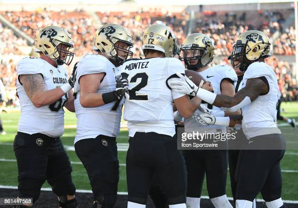 University of Colorado QB Steven Montez is mobbed by teammates after catching a 11yard touchdown pass in the second quarter during a college football...