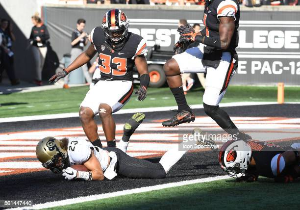 University of Colorado TB Phillip Lindsay dives into the end zone for a second half touchdown against Oregon State University S Jalen Moore during a...