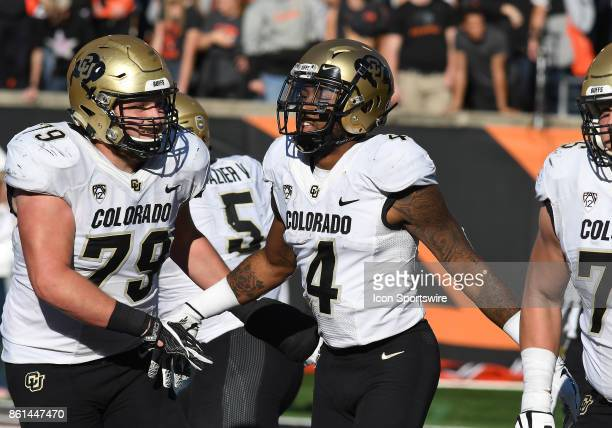 University of Colorado WR Bryce Bobo is congratulated for a touchdown by University of Colorado OL Jonathan Huckins during a college football game...