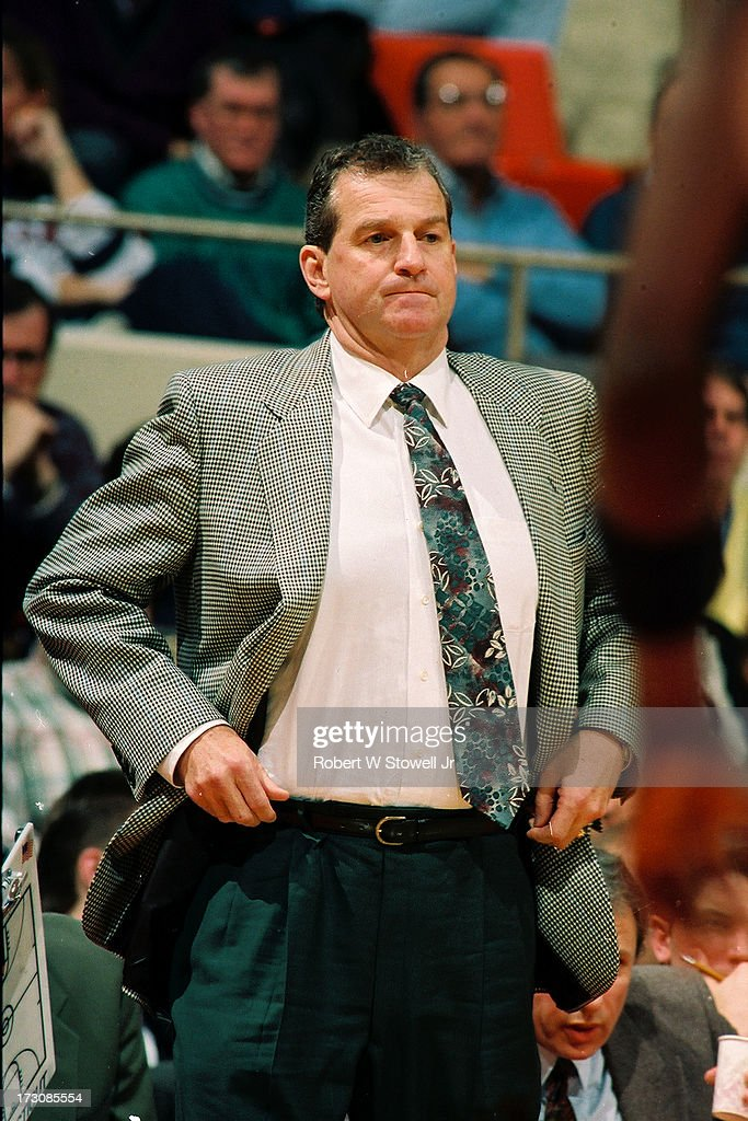 University of Connecticut basketball coach <a gi-track='captionPersonalityLinkClicked' href=/galleries/search?phrase=Jim+Calhoun&family=editorial&specificpeople=208977 ng-click='$event.stopPropagation()'>Jim Calhoun</a> adjusts his belt on the sideline during a game, Hartford, Connecticut, 1994.