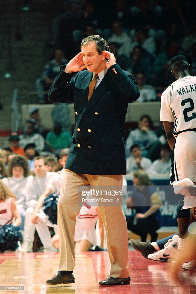 University of Connecticut basketball coach <a gi-track='captionPersonalityLinkClicked' href=/galleries/search?phrase=Jim+Calhoun&family=editorial&specificpeople=208977 ng-click='$event.stopPropagation()'>Jim Calhoun</a> holds his hands to his ears on the sidelines during a game, Hartford, Connecticut, 1989.