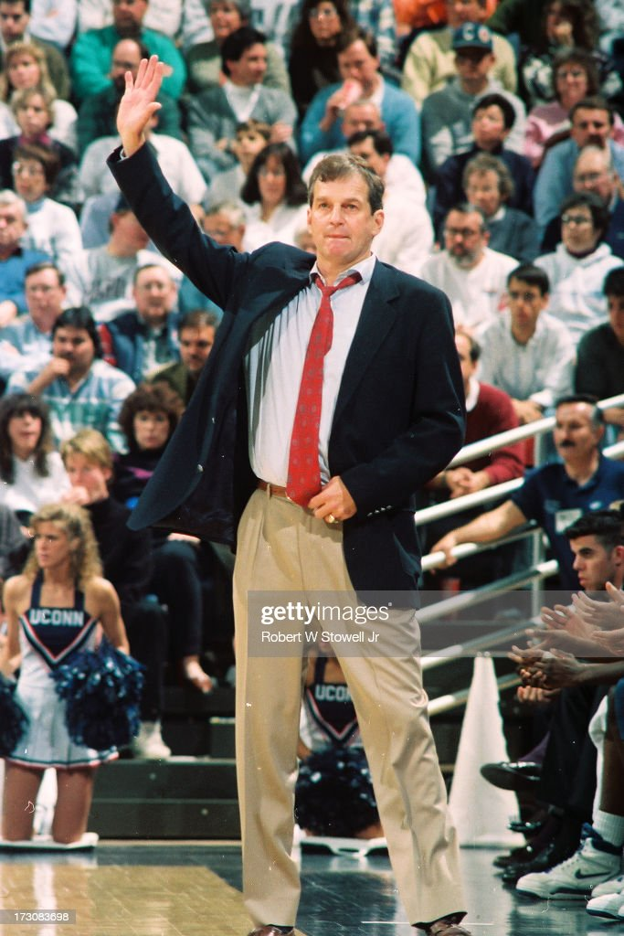 University of Connecticut basketball coach <a gi-track='captionPersonalityLinkClicked' href=/galleries/search?phrase=Jim+Calhoun&family=editorial&specificpeople=208977 ng-click='$event.stopPropagation()'>Jim Calhoun</a> raises his arm on the sideline during a game, Storrs, Connecticut, 1994.
