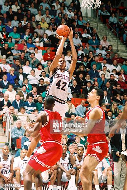University of Connecticut basketball player Donyell Marshall with a jump shot during a game against the Canadian National team Hartford Connecticut...
