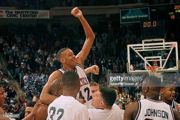 University of Connecticut basketball player Donyell Marshall celebrates with his teammates Hartford Connecticut 1995