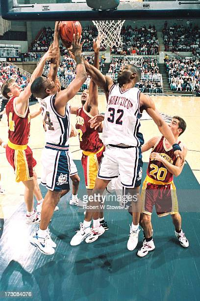 University of Connecticut basketball player Kirk King rebounds during a game against Winthrop Hartford Connecticut 1995