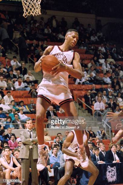 University of Connecticut basketball player Rod Sellers with the ball in the air Hartford Connecticut 1994