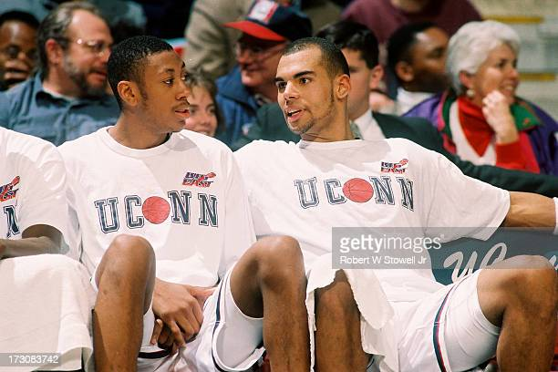 University of Connecticut basketball players Donyell Marshall and Donny Marshall talk on the bench Hartford Connecticut 1994