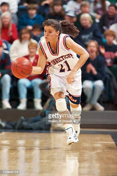University of Connecticut player Jennifer Rizzotti runs the break and dribbles upcourt during a game at Gampel Pavilion in Storrs CT 1996