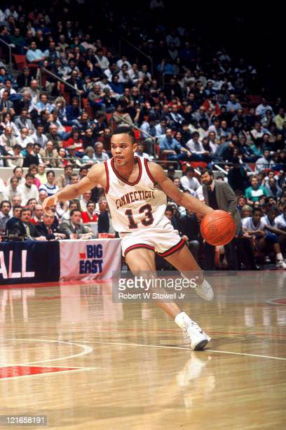University of Connecticut point guard Chris Smith looks upcourt as he dribbles the ball during a Big East game against Seton Hall Hartford...