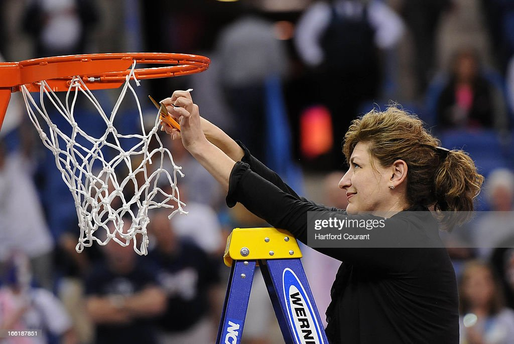 University of Connecticut president Susan Herbst cuts down a piece of the net after a 93-60 win against Louisville in the women's NCAA Tournament finals at New Orleans Arena in New Orleans, Louisiana, Tuesday, April 9, 2013.